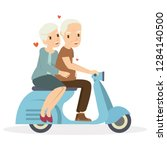 happy old couple riding a...   Shutterstock .eps vector #1284140500