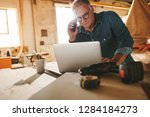 senior man using laptop and... | Shutterstock . vector #1284184273
