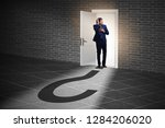 businessman in uncertainty and... | Shutterstock . vector #1284206020