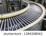 metal conveyor belt... | Shutterstock . vector #1284208063