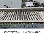 metal conveyor belt... | Shutterstock . vector #1284208066