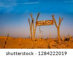 a wooden signpost at the... | Shutterstock . vector #1284222019