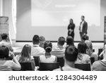 startup team giving a pitch... | Shutterstock . vector #1284304489