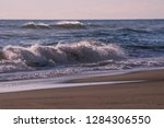 autumn stormy sea on a sunny... | Shutterstock . vector #1284306550