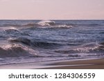 autumn stormy sea on a sunny... | Shutterstock . vector #1284306559