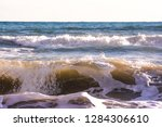 autumn stormy sea on a sunny... | Shutterstock . vector #1284306610