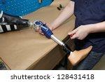 a technician adjusts a... | Shutterstock . vector #128431418