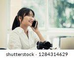 asian businesswoman or office... | Shutterstock . vector #1284314629