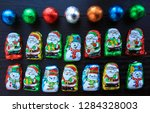 colorful foil wrapped chocolate ... | Shutterstock . vector #1284328003