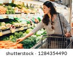 japanese woman in supermarket... | Shutterstock . vector #1284354490