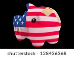 empty piggy rich bank in colors of national flag of us on black background - stock photo