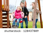 girl sitting on a swing  father ... | Shutterstock . vector #128437889