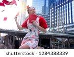 happy beautiful asian woman in... | Shutterstock . vector #1284388339