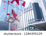 excited asian woman in chinese... | Shutterstock . vector #1284390139