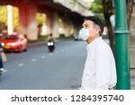 a man wearing mouth mask... | Shutterstock . vector #1284395740