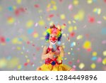 funny kid clown with party... | Shutterstock . vector #1284449896