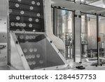 conveyor with lids for bottles... | Shutterstock . vector #1284457753