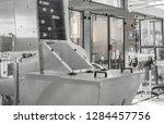 conveyor with lids for bottles... | Shutterstock . vector #1284457756