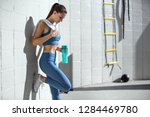 female athlete resting after... | Shutterstock . vector #1284469780
