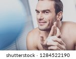 beauty care. handsome male... | Shutterstock . vector #1284522190