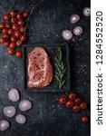 raw beef rib eye steak with... | Shutterstock . vector #1284552520