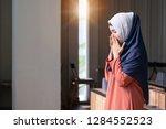 muslim asian woman praying in... | Shutterstock . vector #1284552523