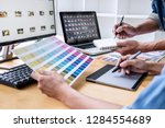 two colleagues creative graphic ... | Shutterstock . vector #1284554689