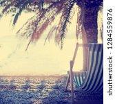 perfect sunset beach. idyllic... | Shutterstock . vector #1284559876