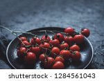 branch of ripe cherry tomatoes... | Shutterstock . vector #1284561043