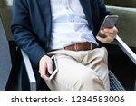 businessman using smartphones...   Shutterstock . vector #1284583006