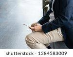 businessman using a smartphone...   Shutterstock . vector #1284583009