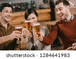happy group of friends clinking ... | Shutterstock . vector #1284641983
