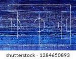 soccer field lines on a wood... | Shutterstock . vector #1284650893