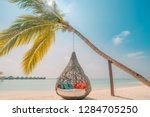 chill lounge zone on the sandy... | Shutterstock . vector #1284705250