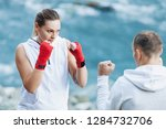 strong and powerful young woman ... | Shutterstock . vector #1284732706