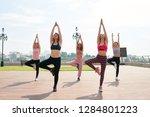 slim ethnic women in sportswear ... | Shutterstock . vector #1284801223