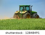 Green Tractor Working In The...