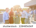 attractive group of friends or... | Shutterstock . vector #1284856369