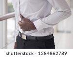 african man suffers from... | Shutterstock . vector #1284862789