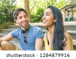happy couple smiling and... | Shutterstock . vector #1284879916