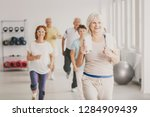 smiling senior fitness instruct ... | Shutterstock . vector #1284909439