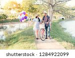happy couple with bicycle...   Shutterstock . vector #1284922099