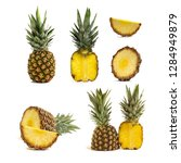 fresh whole and cut pineapple... | Shutterstock . vector #1284949879