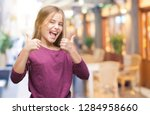 young beautiful girl over... | Shutterstock . vector #1284958660