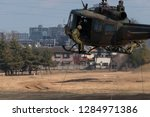 helicopter and soldiers | Shutterstock . vector #1284971386