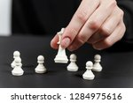 a human hand moving king chess... | Shutterstock . vector #1284975616