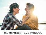 happy gay couple dating next... | Shutterstock . vector #1284980080