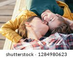 happy gay couple lying on a... | Shutterstock . vector #1284980623