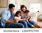 young hispanic family of four... | Shutterstock . vector #1284992743