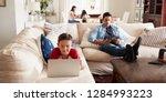 pre teen boy lying on sofa... | Shutterstock . vector #1284993223